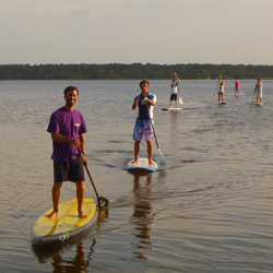 Location et balade en SUP stand up paddle sur le lac de lacanau moutchic France